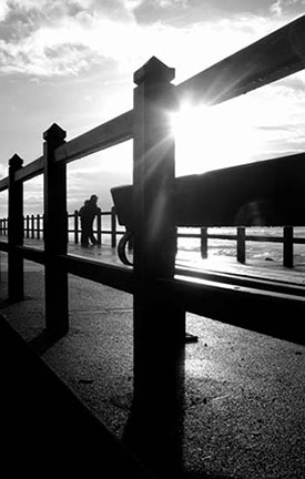 Support: Couple on pier looking out into the distance
