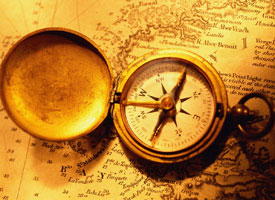 Adversity: Antique compass and map