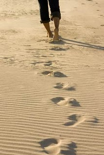 Loss: Footprints through the sand
