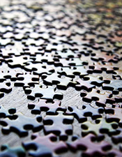 Meaning: Table top covered in puzzle pieces