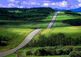Transition: Long winding road through hillside